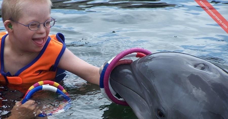 Дельфинотерапия при синдроме Дауна